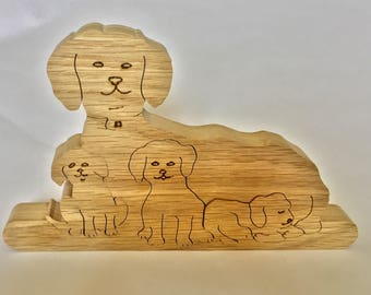 Dog family. Wooden dog with puppies. Wooden animals, home decoration for dog lovers. Family of dogs.