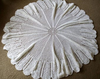 This lovely baby shawl cercular and in white acrylic