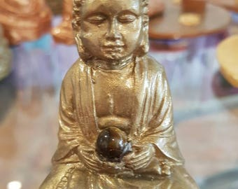 Buddha statue with Tiger eye