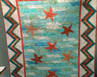 Handmade appliqued starfish throw or lap quilt.