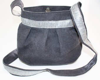 Small purse from gray suede and silver glitter band