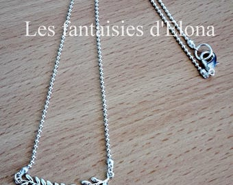 "Long silver necklace with pendant ""fern"""