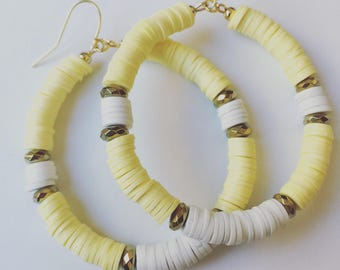 Yellow and white earrings with gold accent