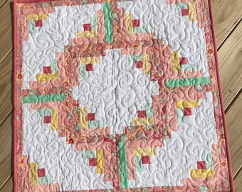 Quilted table topper in log cabin design