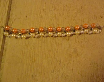 Peach and Pearl Colored Bracelet
