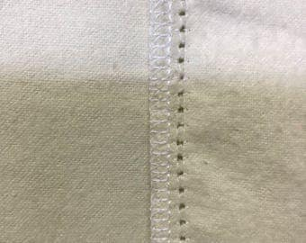Cream on Cream hemstitched flannel baby blanket