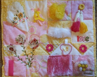 Fidget Blanket yellow and pink with many sensory activities and made with LOVE