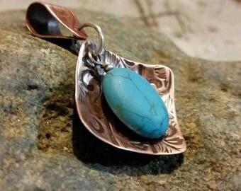 Embossed copper pendant