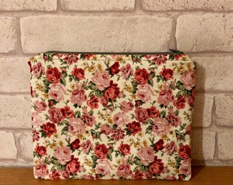 Handmade Floral Multi-Use Bag. Can be used to store anything such as stationary, make-up, toiletries etc. Lined and washable.