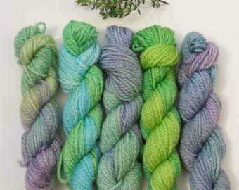 Set of five 10g mini skeins on merino and bamboo blend 4ply knitting wool yarn in purples and greens