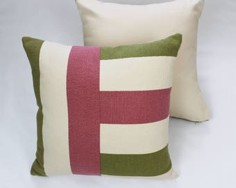 Decorative pillow crafted from vintage pink and green barkcloth and new designer fabric.