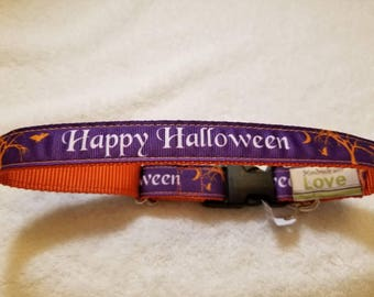 Happy Halloween collar. Purple background with white lettering and orange bats, moon, tree. XL collar, fits up to 21 inch neck. 1 inch wide.