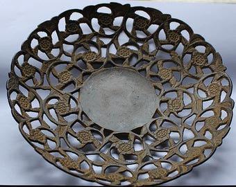 With a fine decorative cast iron trivet