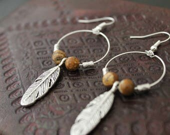 Earrings circles Brown beads and feathers