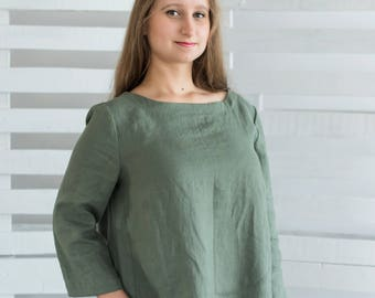 Linen blouse with three quarter sleeves washed linen light moss green color.