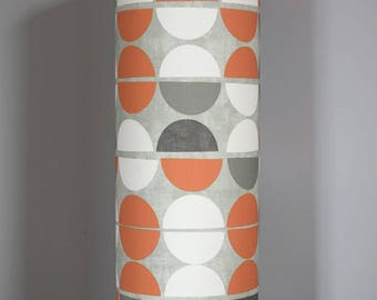Tall lampshade with floor lamp base option, fabric made and printed in England. handmade by vivid shades, cool geometric orange and grey