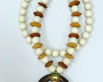 Cresent Tusk pendant necklace