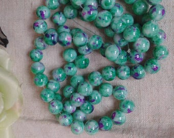 set of 10 green marbled with purple glass beads