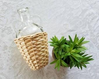 Wicker covered glass jug/vase