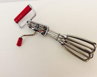 Beater or mixer manual with red handles