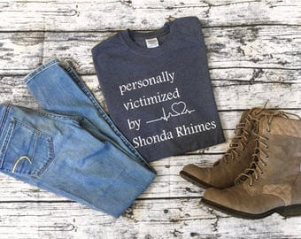 """Grey's Anatomy """"Personally Victimized by Shonda Rhimes"""" t-shirt! Dark gray with write writing. Cute, casual, and comfy!"""
