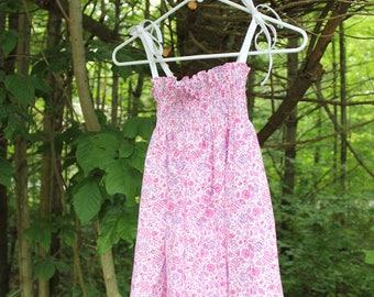 Liberty of London, cotton, pink and purple smocked dress.