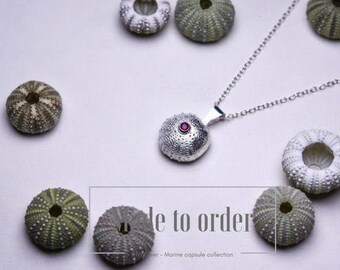 Silver and ruby sea anemone pendant