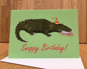 Snappy birthday! Crocodile eating birthday cake, happy birthday card
