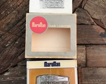 Vintage collectible silver tone MaruMan Sea-Wide gas cigarette lighter in original box and instruction booklet
