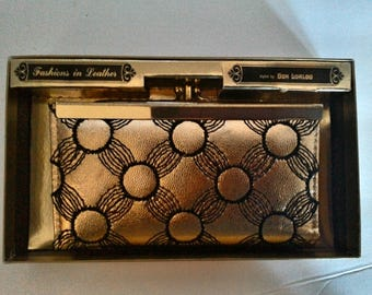 Gold Billfold/wallet with black stitched flowers.