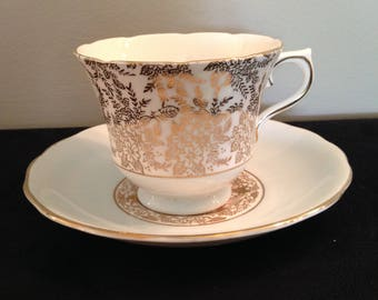 Royal Vale (Colclough)  Pale Blue wash Gold Filigree Tea Cup and Saucer