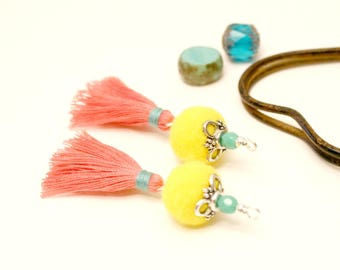 2 PomPoms, yellow and Rose, 5.5 cm, faceted Turquoise Tassel