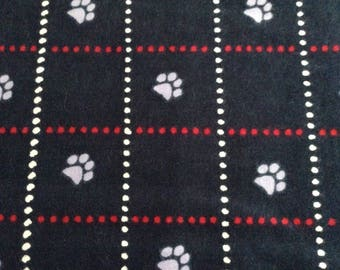 Flannel animal paw prints on navy blue background cotton fabric by the yard