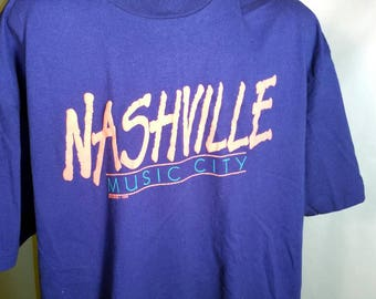 1989 Nashville Music Graphic Blue Soft Tee Sz XL 80s 1980s 90s 1990s Retro Neon Font Text Country Western Rock & Roll Hanes Polycotton TN