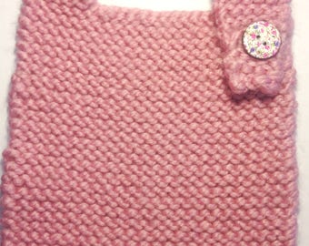 Hand knitted baby bib with cute floral button fastening