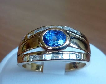 Gold ring with oval blue sapphire and diamonds