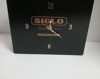Beautiful black cigar box with gold lettering clock