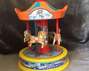 Vintage musical carousel merry go round by Redbox with melody its a small world
