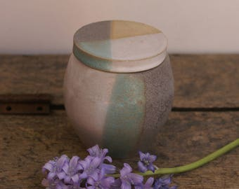 Grey and white sugar jar with lid and rawpot areas