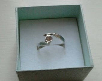 Handcrafted solitaire zirconia sterling silver ring.