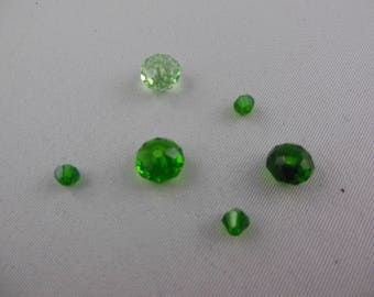 Swarovski round flattened green beads