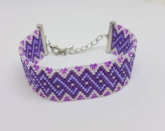 Bracelet weaved in pearls Miyuki Délicas purple