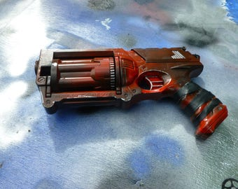 Red raider themed Nerf Gun with weathering