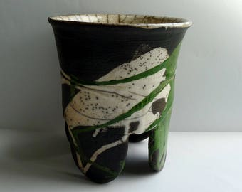 Raku pot with rounded feet in green and clear glaze
