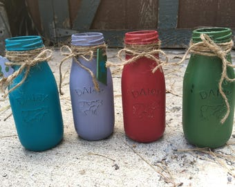 Shabby chic very cute painted glass milk bottles.