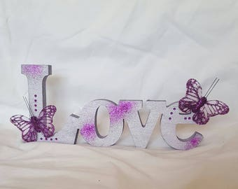 Purple wooden LOVE ornament with butterflies