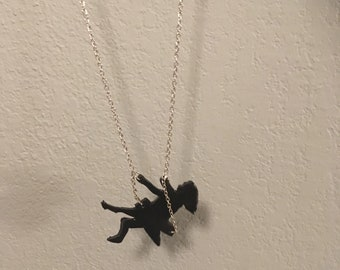 Swinging girl poly clay necklace
