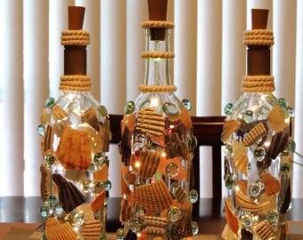 wine bottles, wine bottle lights, glass, led lights, decoration, decor, sea shells, beach, glass beads