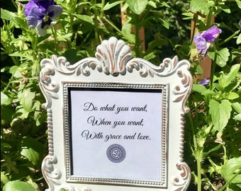 Beautiful metal, white frame with motivational words to help fill you with bliss...