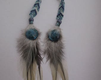 Blue earrings with feathers and Brazilian weaving